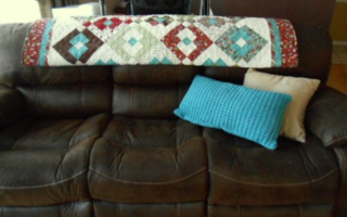 Christmas quilt on couch